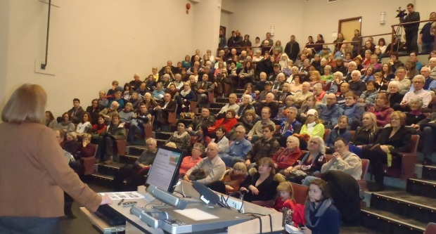 Dr. Jill Calder speaks to overflow crowd at TRU Clocktower Theatre on Ajax today.