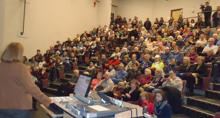 Dr. Jill Calder speaks to overflow crowd at TRU Clocktower Theatre on Ajax today.