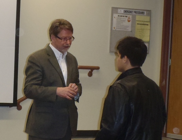 Dr. Paul Evans, left, talks with student after presentation at TRU Wednesday night.