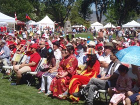 Colourfully dressed audience for opening ceremonies.