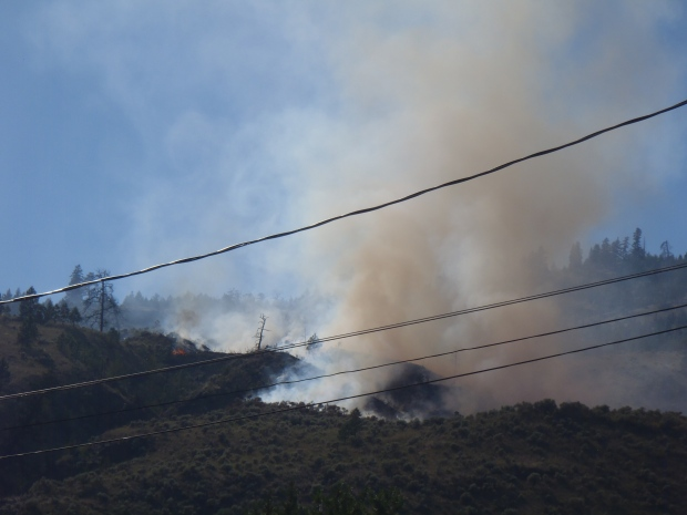 Brush fire above Westsyde sent smoke and flames into air Friday afternoon.