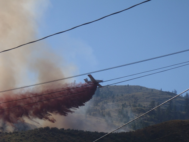 Retardant painted the hill orange above Westsyde. (A.M. News photos)