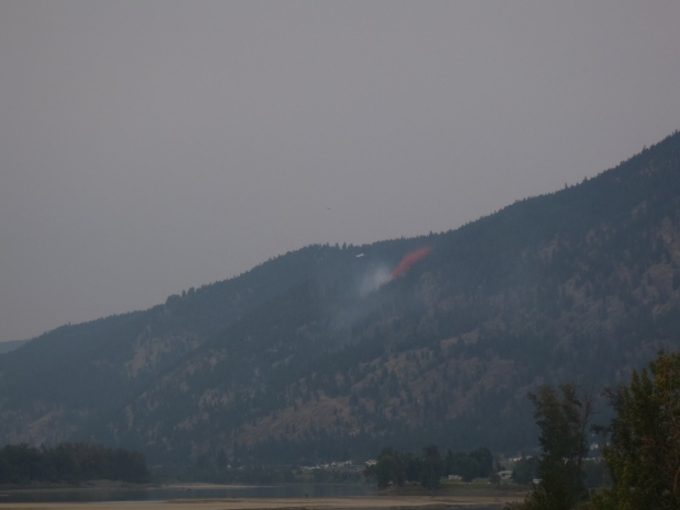 Retardant was dropped on fire across river from Whispering Pines.