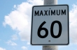 A sign road for a speed limit to sixty