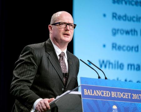 Finance Minister Mike de Jong unveils his budget. (BC Govt photo)