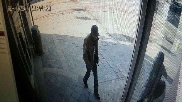 Surveillance camera photo of suspect at bank.