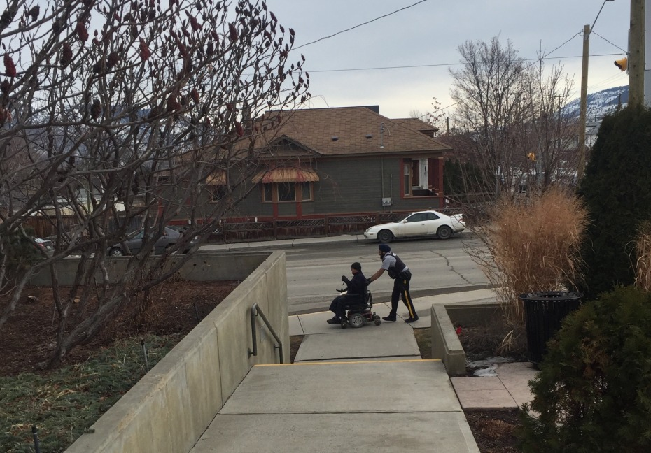 Cst. Sukhdeep Toor lends a helping hand to resident in need of a push home.