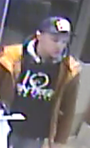 Surveillance photo of suspect in credit-card theft.