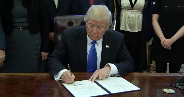 trumpdonald-signing-screengrab